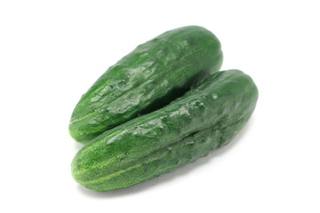 a pair of green cucumbers isolated on white background