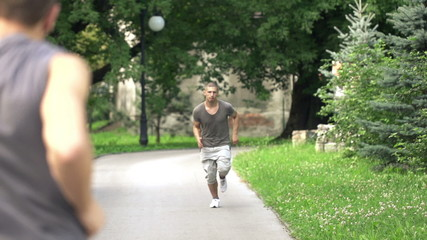 Men jogging in the city park, super slow motion, 240fps