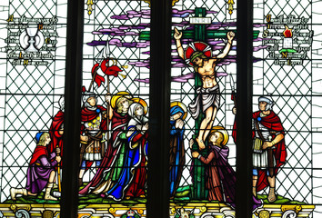 Crucified Jesus with woman and soldieers in stained glass