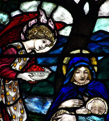 Mary feeding Jesus in stained glass
