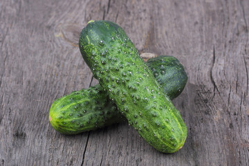 Cucumbers on old wood background