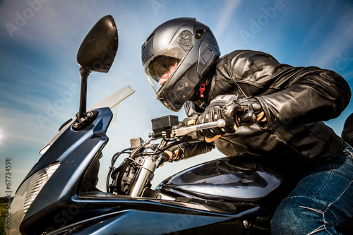 canvas print picture Biker racing on the road
