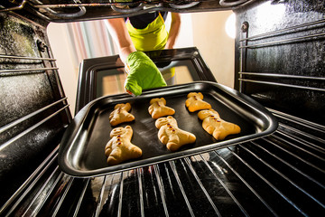 Baking Gingerbread man in the oven