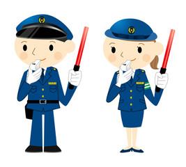誘導灯を持つ警察官