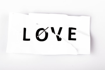 """Love"" word written on torn and stapled paper"