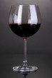 Red wine glass on grey background