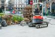 Ruspa escavatore, cantiere rifacimento pavimentazione