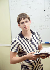 Portrait of a beautiful young student with book