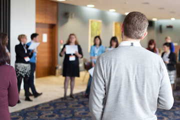 people standing at conference break