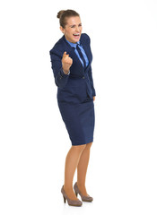 Full length portrait of happy business woman pointing in camera