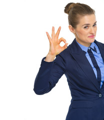 Smiling business woman showing ok gesture