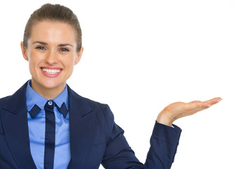 Smiling business woman presenting something on empty palm
