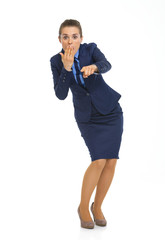 Portrait of surprised business woman pointing in camera