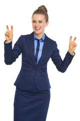 Smiling business woman making finger quote marks