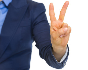 Closeup on business woman showing 2 fingers