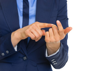 Closeup on business woman counting on fingers