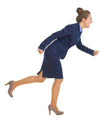 Full length portrait of smiling business woman running