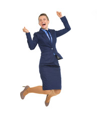 Full length portrait of happy business woman jumping