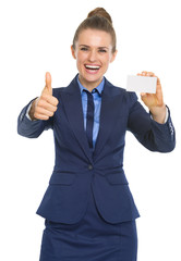 Portrait of smiling business woman showing business card