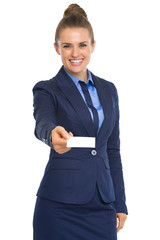 Portrait of happy business woman giving business card