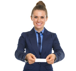 Portrait of happy business woman showing business card