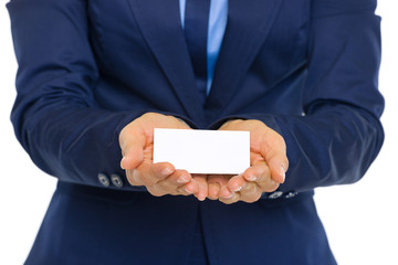 Closeup on business woman showing business card