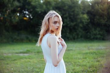 beauty woman in dress portrait over green background