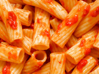 maccheroni pasta in tomato sauce food background
