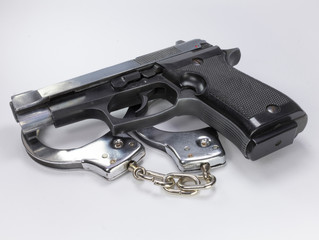 steel gun and handcuffs to stop criminals