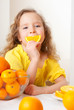 canvas print picture - Child with oranges