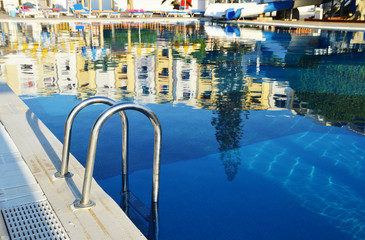 Swimming pool in touristic resort during summer time