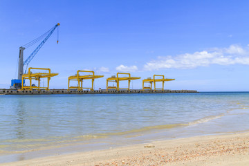 Industrial cranes and cargo on port