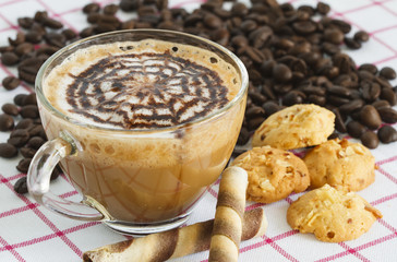 Coffee cup and beans with cookies