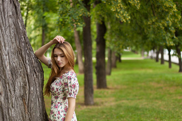 Attractive Young Woman Walking in The Park