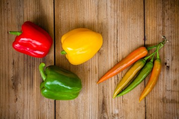 Red, green, yellow bell  and hot peppers