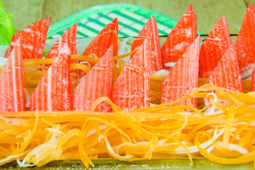 crab stick with fresh vegetables in plate