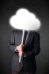 Businessman holding a cloud