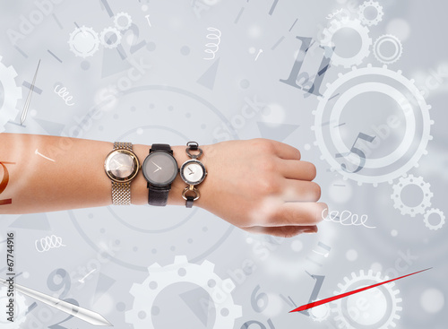 Hand with watch and numbers on the side comming out - 67744916