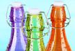 Colorful bottles on light blue background