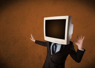 Business man with a monitor on his head and brown empty space