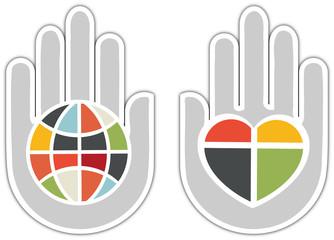 Globe et coeur dans les mains