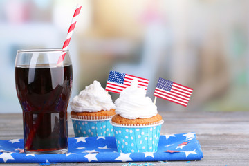American patriotic holiday cupcakes and glass of cola