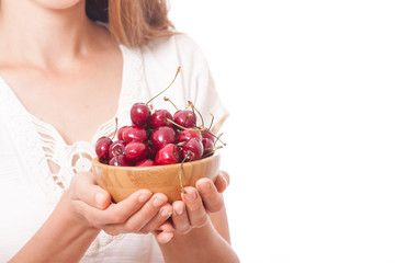 bowl of cherries in women's hands