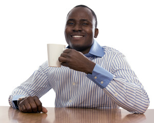 African man with cup of tea, sitting on the desk