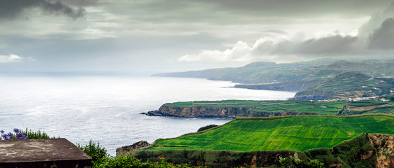Azores Islands coastline in dramatic sky