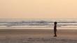 boy play footbol on the beach