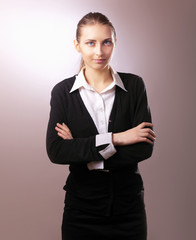 Portrait of business woman standing with folded arms