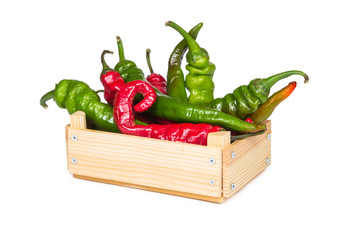 Spicy hot peppers in a wooden box