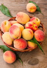 Ripe peaches in a wicker basket