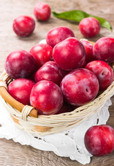 Ripe plum in a wicker basket